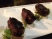 Dates stuffed with goat cheese and wrapped with pastourma